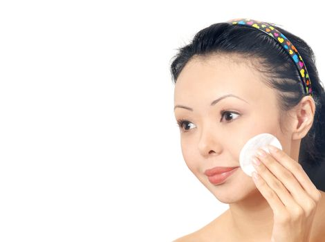 Asian woman cleaning face by cosmetic sponge