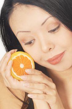 Close-up portrait of the pretty woman with fresh lemon
