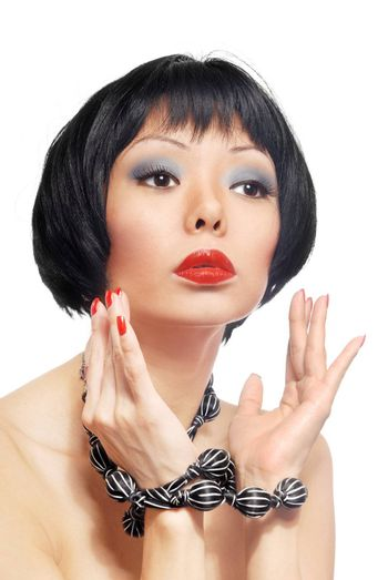Beauty model with tied hands and stylish make-up
