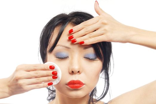 Beauty photo of the pretty woman applying make-up sponge