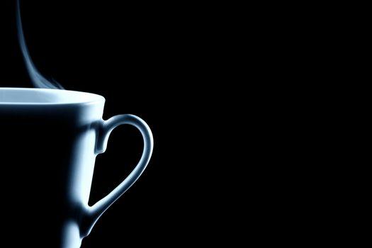 half steaming coffee cup on black