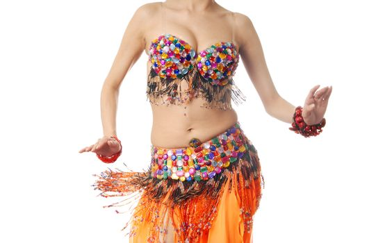 Photo of the active lady in Oriental costume dancing belly-dance