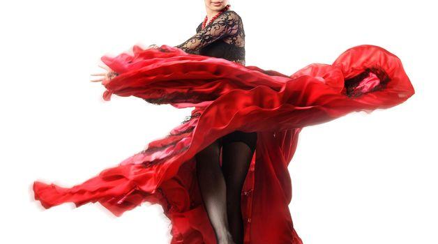 Elegant flamenco dancer with motion of her skirt