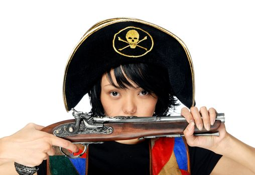 Woman in pirate costume with ancient pistol in hands