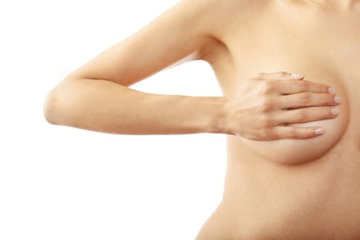 Woman breast covered by the hand on a white background