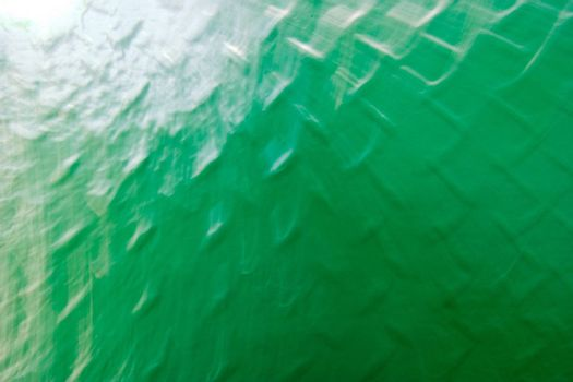 A green grid metal texture background