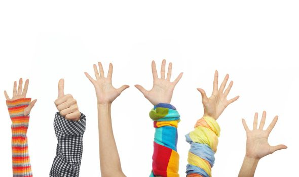 Six happy human hands in the various clothes