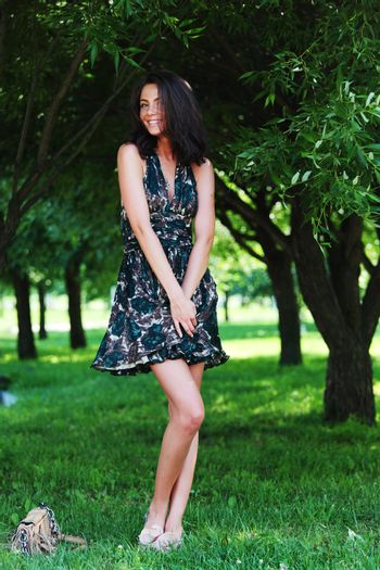 girl on a background of green trees