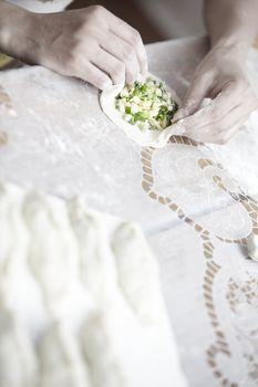 Human hands preparing ties