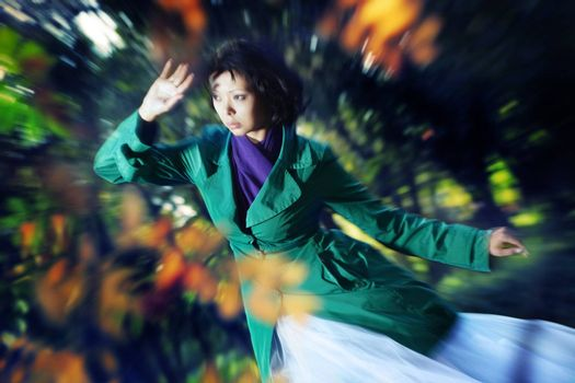 Lady outdoors in autumn. Photo with zoom-in blur effect