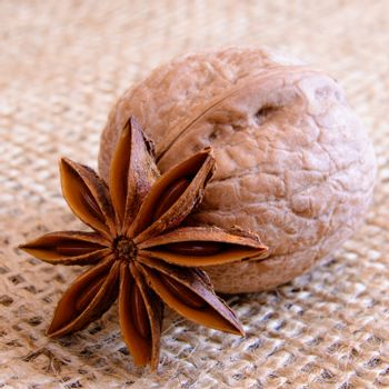 Walnuts and Star Anise on Burlap Background