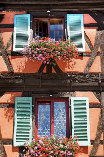 Flowers and windows in the city of Colmar France