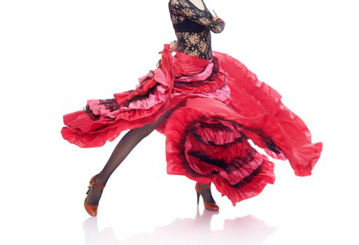 Unrecognizable lady in Gypsy costume dancing flamenco on a white background