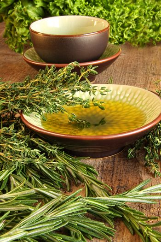 Fresh herbs on wooden cutting board