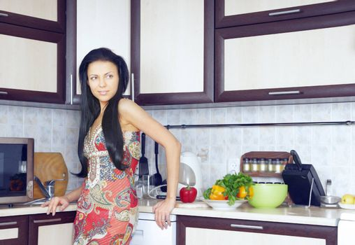 Fashionable lady standing in the kitchen