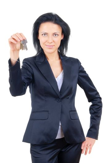 Businesswoman on a white background holding out house keys