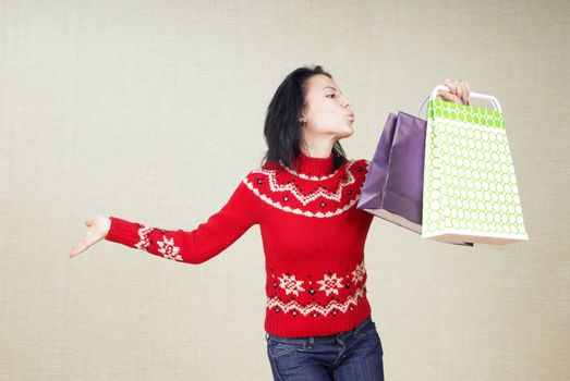 Playful lady with gift bags in the red sweater