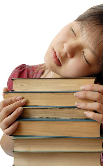 Photo of young student sleeping on the numerous books