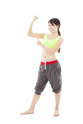 happy young fitness woman pointing the muscle