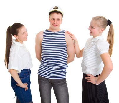 Two girls and a sailor. Isolated on white background