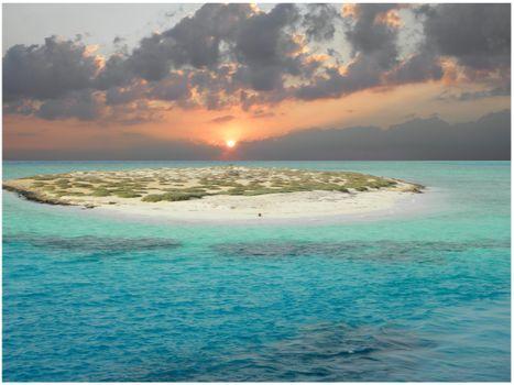 Dream island in the Red Sea. Cloudscape over an island