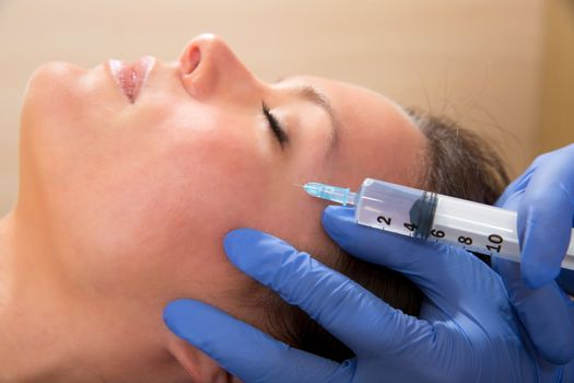 Anti aging facial mesotherapy syringe on woman face