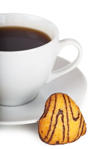 Cup of coffee with heart shaped cookies over white background