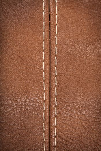 Closeup view of leather material jointed by stitch