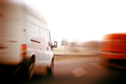 Trucks, delivery vans on freeway
