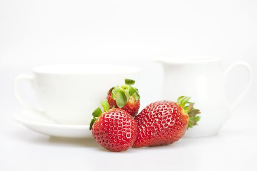 juicy strawberries and tableware isolated on white