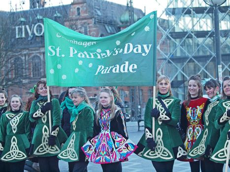COPENHAGEN - MAR 17: Participants wearing colourful costumes at the annual St. Patrick's Day celebration and parade in front of Copenhagen City Hall, Denmark on March 17, 2013.