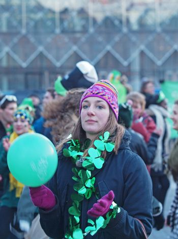 COPENHAGEN - MAR 17: Woman spectator at the annual St. Patrick's Day celebration and parade in front of Copenhagen City Hall, Denmark on March 17, 2013.
