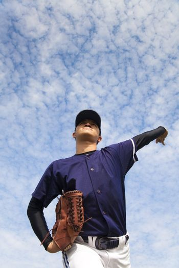 baseball pitcher with cloud backgroung