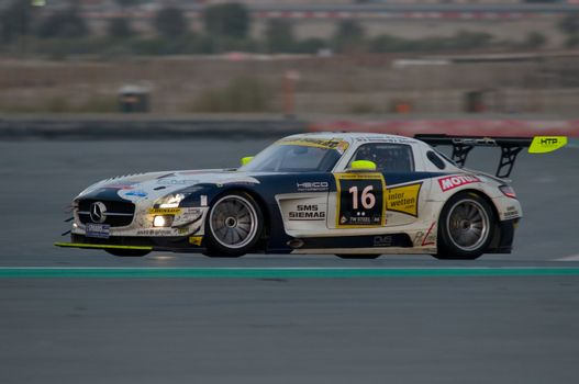 DUBAI - JANUARY 14: Car 16, a Mercedes SLS AMG GT3, during the morning hours of the 2012 Dunlop 24 Hour Race at Dubai Autodrome on January 14, 2012.