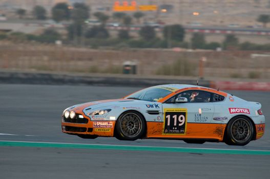 DUBAI - JANUARY 14: Car 119, an Aston Martin Vantage N24 GT4 with the classic Gulf paint scheme, during the morning hours of the 2012 Dunlop 24 Hour Race at Dubai Autodrome on January 14, 2012.