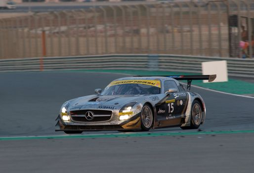 DUBAI - JANUARY 14: Car 15, a Mercedes SLS AMG GT3, during the morning hours of the 2012 Dunlop 24 Hour Race at Dubai Autodrome on January 14, 2012.