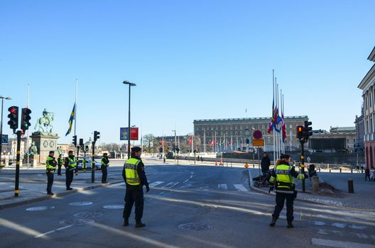 Swedish policemen in front of the Royal Palace in Stockholm at the turkish state visit in march 2013