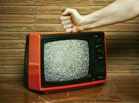 Fist smashing a TV