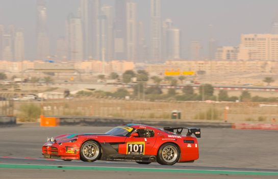 DUBAI - JANUARY 14: Car 101, a Dodge Viper with Dubai City in the background, during the 2012 Dunlop 24 Hour Race at Dubai Autodrome on January 14, 2012.