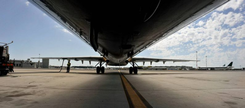 View of an airliner parked during refueling.