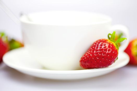 Strawberry on the cup and saucer