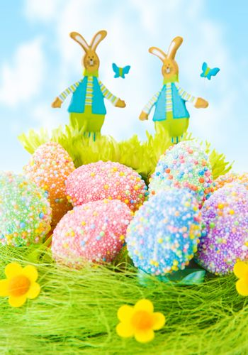 Colorful Easter eggs, beautiful painted eggs on the grass, diversity of traditional decorations for Christian spring holiday
