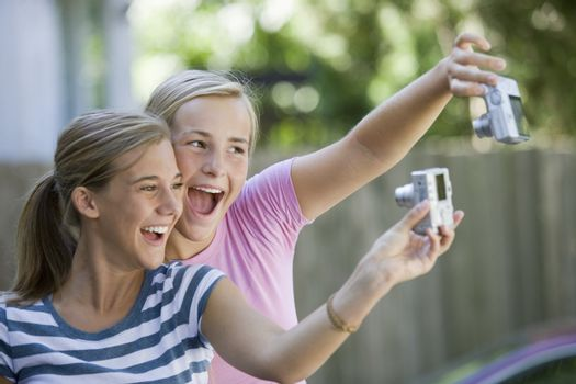 Teenagers with cameras