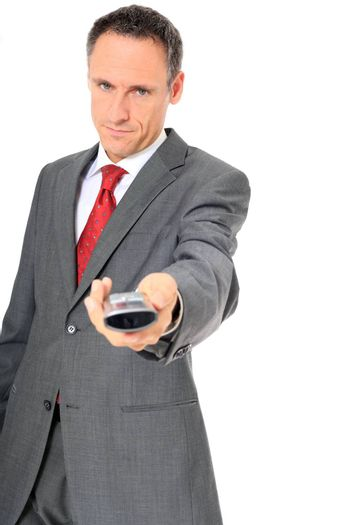 Businessman passes phone to someone. All on white background.