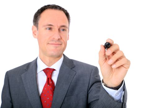 Attractive businessman using marker. Focus on hand ind foreground. All on white background.