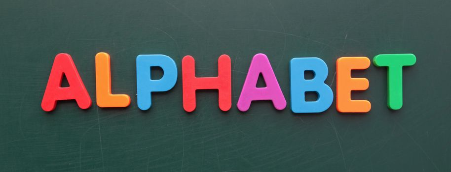 The term alphabet in colorful letters on a blackboard.