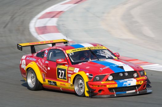 DUBAI - JANUARY 13: Car 27, a Ford Mustang, participating in the 2012 Dunlop 24 Hour Race at Dubai Autodrome on January 13, 2012.