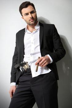 Man Holding a fire gun and smoking a cigar