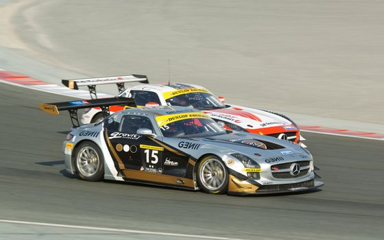 DUBAI - JANUARY 13: Two Mercedes SLS AMG GT3 competing in the 2012 Dunlop 24 Hour Race at Dubai Autodrome on January 13, 2012.