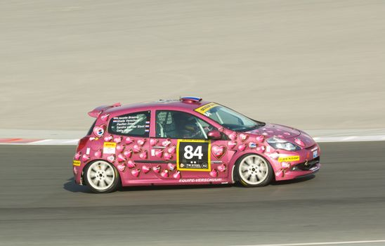 DUBAI - JANUARY 13: Car 84, a Renault Clio RS Cup with an all female team from the Netherlands, participating in the 2012 Dunlop 24 Hour Race at Dubai Autodrome on January 13, 2012.